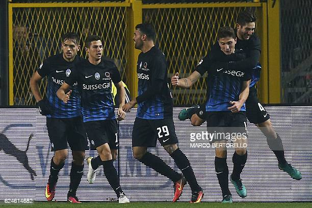 Atalanta's defender Mattia Caldara celebrates with his teammates after scoring during the Italian Serie A football match Atalanta vs As Roma on...