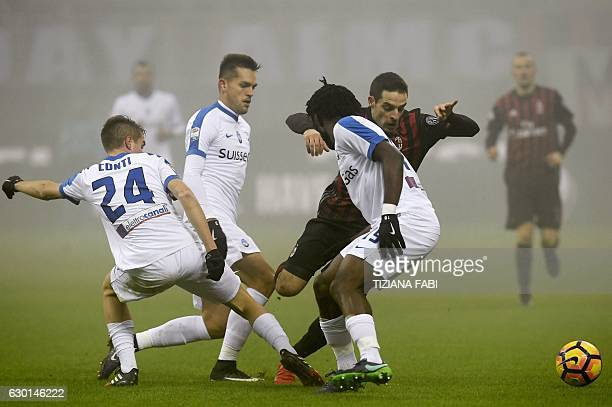 Atalanta's defenders Carlos Carmona from Chile and Andrea Conti from Italy vie with AC Milan midfielder of Italy Giacomo Bonaventura during the Serie...