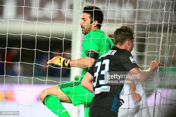 Atalanta's Dutch defender Hans Hateboer celebrates after Atalanta's Italian defender Andrea Conti scores against Juventus goalkeeper Gianluigi Buffon...