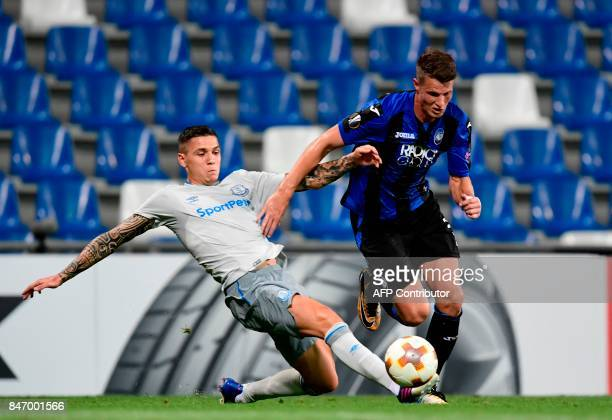 Atalanta's Dutch defender Hans Hateboer vies with Everton's German midfielder Muhamed Besic during the UEFA Europa League Group E football match...