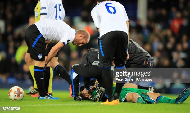 Atalanta's Etrit Berisha lays injured during the UEFA Europa League Group E match at Goodison Park Liverpool