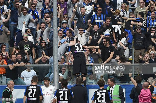 Atalanta's forward from Chile Mauricio Pinilla celebrates with fans after scoring during the Italian Serie A football match Atalanta vs AC Milanon on...