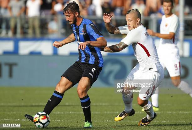 Atalanta's German defender Robin Gosens vies with AS Roma's Belgian midfielder Radja Nainggolan during the Italian Serie A football match between...