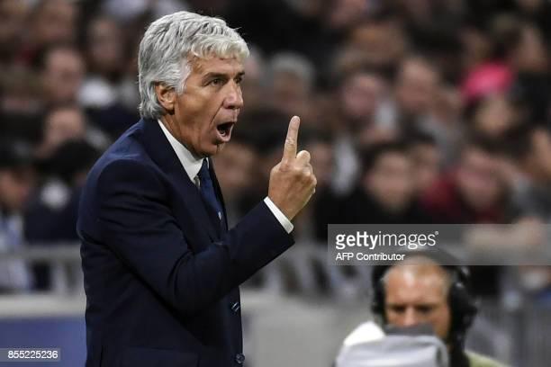 Atalanta's Italian coach Gian Piero Gasperini gestures and reacts during the Europa League football match between Olympique Lyonnais and Atalanta BC...