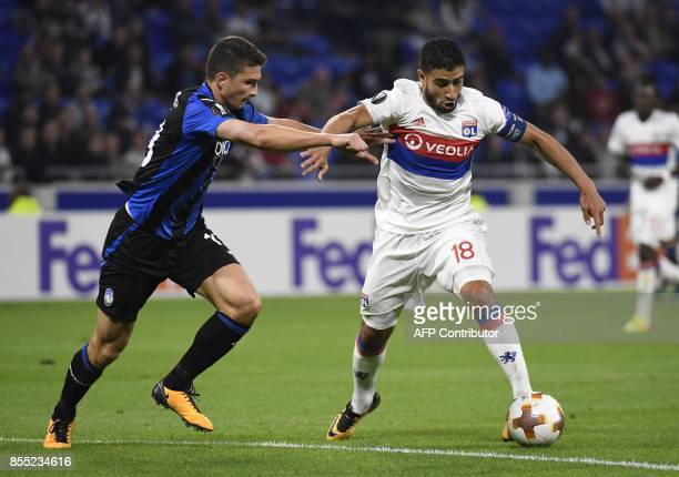 Atalanta's Italian defender Mattia Caldara fights for the ball with Lyon's French midfielder Nabil Fekir during the UEFA Europa Cup Group E football...