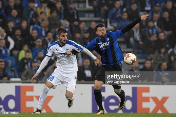 Atalanta's Italian forward Andrea Petagna vies with Apollon Limassol's Romanian midfielder Andrei Pitian during the UEFA Europa League group E...
