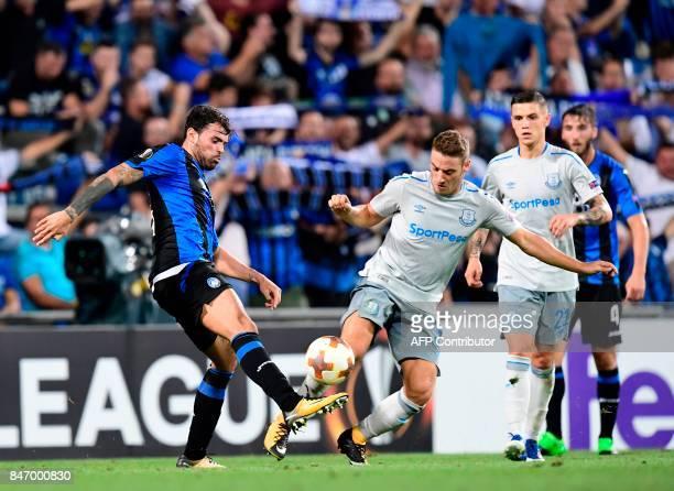 Atalanta's Italian forward Andrea Petagna vies with Everton's Croatian forward Nikola Vlasic during the UEFA Europa League Group E football match...