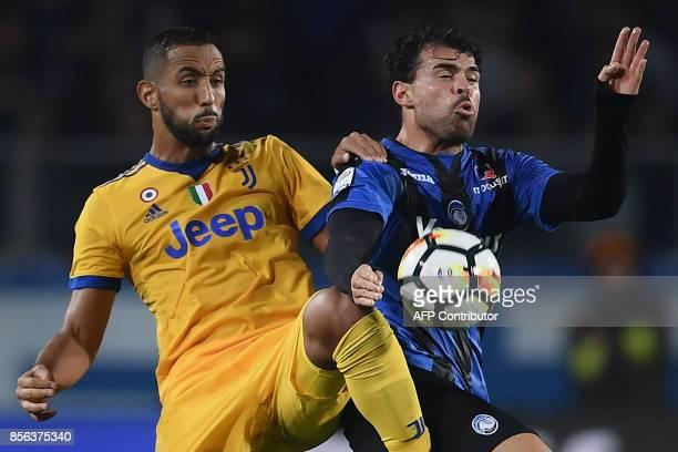 Atalanta's Italian forward from Italy Andrea Petagna fights for the ball with Juventus' Moroccan defender Medhi Amine Benatia during the Italian...
