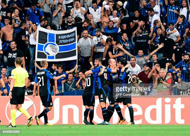 Atalanta's Italian midfielder Brian Cristante is congratulated by teammates after scoring the third goal during the UEFA Europa League Group E...