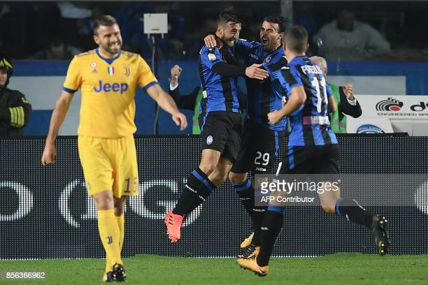 Atalanta's Italian midfielder Bryan Cristante celebrates with teammates after scoring a goal during the Italian Serie A football match between...