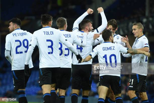 Atalanta's Italian midfielder Bryan Cristante celebrates with teammates scoring the team's second goal during the UEFA Europa League Group E football...