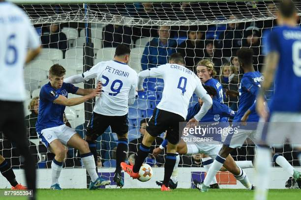 Atalanta's Italian midfielder Bryan Cristante scores the team's first goal during the UEFA Europa League Group E football match between Everton and...