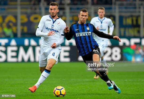 Atalanta's Italian midfielder Bryan Cristante vies with Inter Milan's Croatian forward Ivan Perisic during the Italian Serie A football match between...