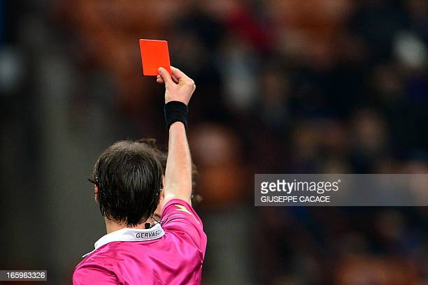 Atalanta's Italian midfielder Cristian Raimondi receives a yellow card from the referee Andrea Gervasoni during the Italian Serie A football match...