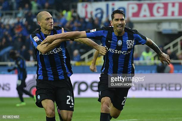 Atalanta's midfielder from Italy Marco Borriello celebrates after scoring during the Italian Serie A football match Atalanta vs AS Roma on April 17...