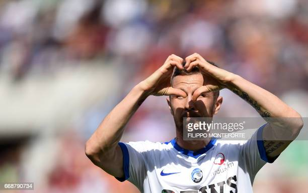 Atalanta's midfielder from Slovenia Jasmin Kurtic celebrates after scoring during the Italian Serie A football match AS Roma vs Atalanta at the...