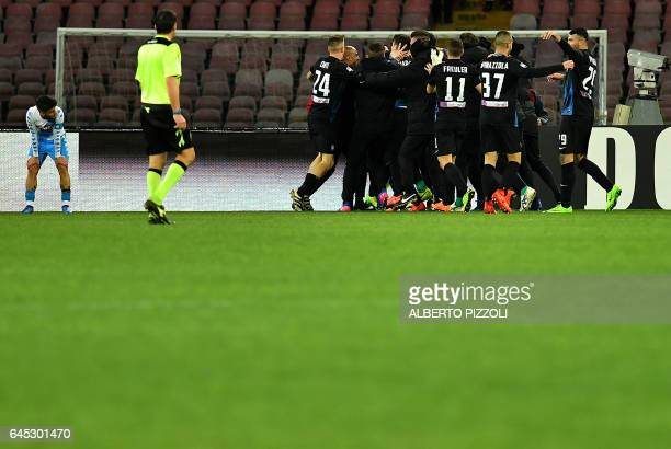 Atalanta's players celebrate after Atalanta's defender Mattia Caldara scored during the Italian Serie A football match Napoli vs Atalanta on February...