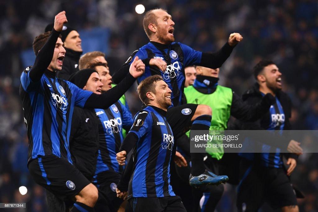 Atalanta's team celebrate at the end of the UEFA Europa League group E football match Atalanta vs Olympique Lyonnais at the Mapei Stadium in Reggio Emilia on December 7, 2017. /