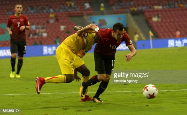 Atalay Babacan of Turkey is in action against Boubacar Haidara of Mali during the ceremony within a 2017 FIFA U17 World Cup football match between...