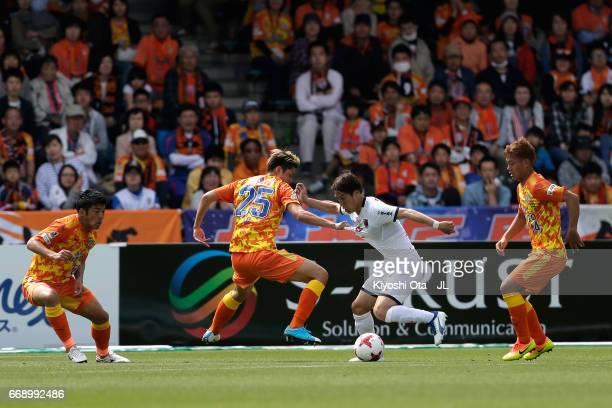 Ataru Esaka of Omiya Ardija and Ko Matsubara of Shimizu SPulse compete for the ball during the JLeague J1 match between Shimizu SPulse and Omiya...