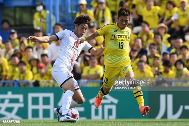 Ataru Esaka of Omiya Ardija and Ryuta Koike of Kashiwa Reysol compete for the ball during the JLeague J1 match between Kashiwa Reysol and Omiya...