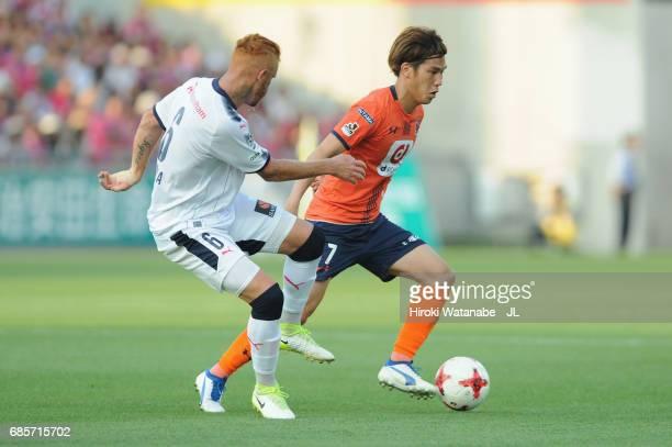Ataru Esaka of Omiya Ardija and Souza of Cerezo Osaka compete for the ball during the JLeague J1 match between Omiya Arija and Cerezo Osaka at NACK 5...