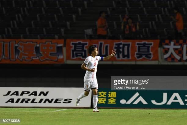 Ataru Esaka of Omiya Ardija celebrates scoring the opening goal during the JLeague J1 match between Sanfrecce Hiroshima and Omiya Ardija at Edion...
