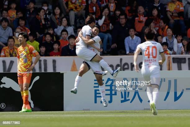 Ataru Esaka of Omiya Ardija celebrates scoring the opening goal with his team mate Daisuke Watabe during the JLeague J1 match between Shimizu SPulse...