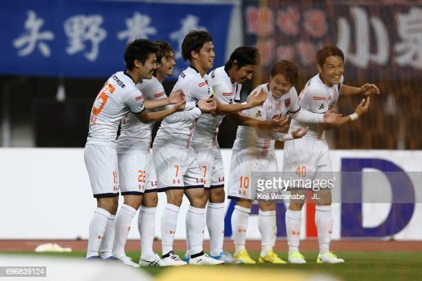 Ataru Esaka of Omiya Ardija celebrates scoring the opening goal with his team mates during the JLeague J1 match between Albirex Niigata and Omiya...