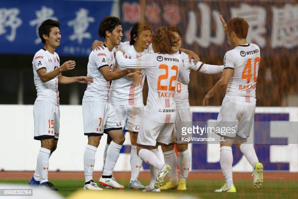 Ataru Esaka of Omiya Ardija celebrates scoring the opening goal with his team mates during the JLeague J1 match between Albirex Niigata and Omiya...