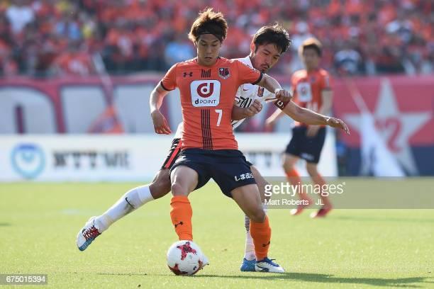 Ataru Esaka of Omiya Ardija competes for the ball against Yuki Abe of Urawa Red Diamonds during the JLeague J1 match between Omiya Ardija and Urawa...