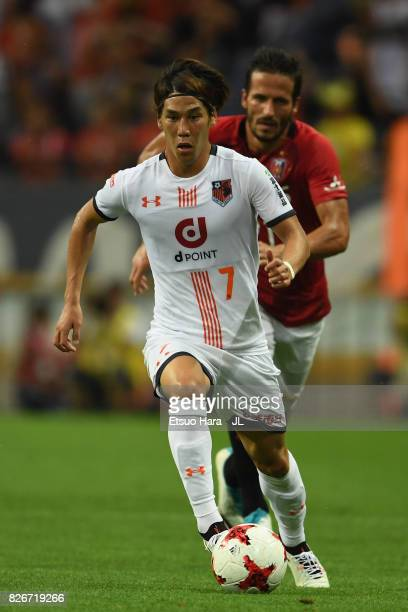 Ataru Esaka of Omiya Ardija controls the ball under pressure of Zlatan Ljubijankic of Urawa Red Diamonds during the JLeague J1 match between Urawa...