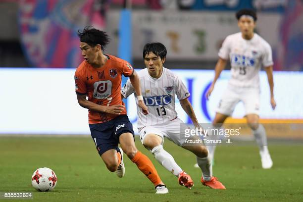 Ataru Esaka of Omiya Ardija controls the ball under pressure of Yuzo Kobayashi of Sagan Tosu during the JLeague J1 match between Sagan Tosu and Omiya...