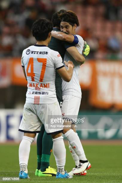 Ataru Esaka of Omiya Ardija is congratulated by Yuzo Iwakami and Kenya Matsui during the JLeague J1 match between Albirex Niigata and Omiya Ardija at...