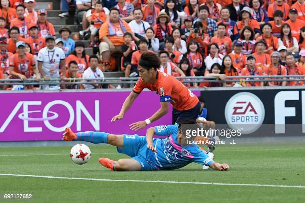 Ataru Esaka of Omiya Ardija is tackled by Yuzo Kobayashi of Sagan Tosu during the JLeague J1 match between Omiya Ardija and Sagan Tosu at NACK 5...