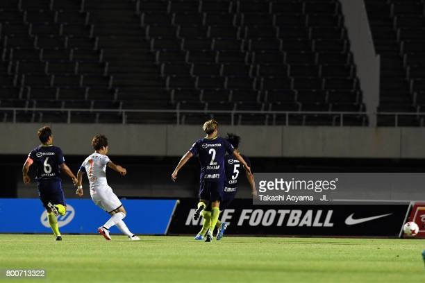 Ataru Esaka of Omiya Ardija socres the opening goal during the JLeague J1 match between Sanfrecce Hiroshima and Omiya Ardija at Edion Stadium on June...