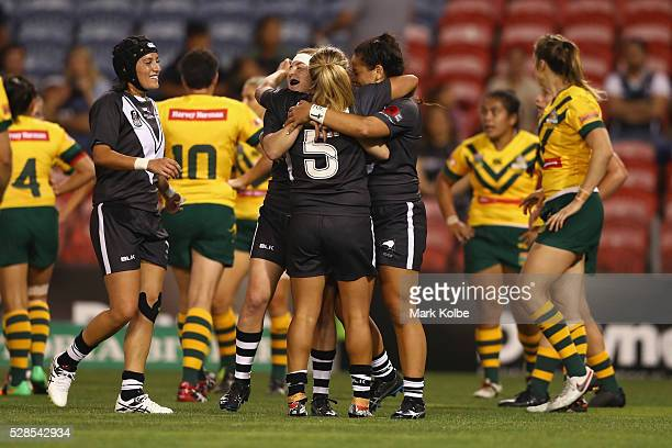 Atawhai Tupaea of the Kiwi Ferns celebrates with her team mates after scoring a try during the Women's international Rugby League Test match between...