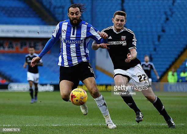 Atdhe Nuhiu of Sheffield Wednesday and Jack O'Connell of Brentford challenge for the ball during the Sky Bet Championship match between Sheffield...