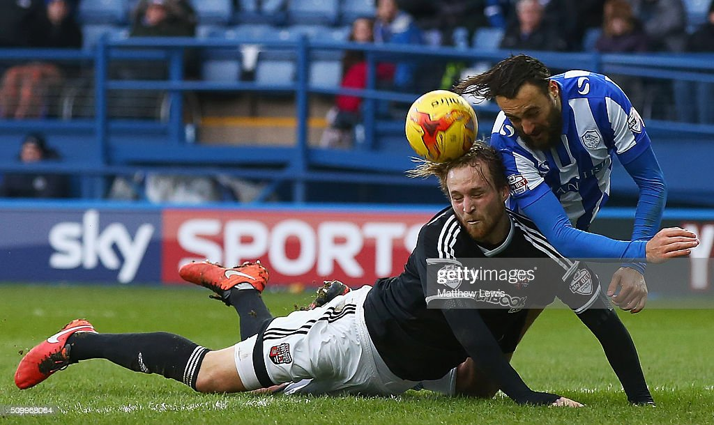 Atdhe Nuhiu of Sheffield Wednesday and Philipp Hofmann of Brentford challenge for the ball during the Sky Bet Championship match between Sheffield Wednesday and Brentford at Hillsborough Stadium on February 13, 2016 in Sheffield, United Kingdom.