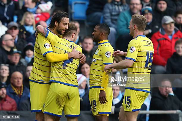 Atdhe Nuhiu of Sheffield Wednesday celebrates with teammates after scoring the opening goal during the FA Cup Third Round match between Manchester...