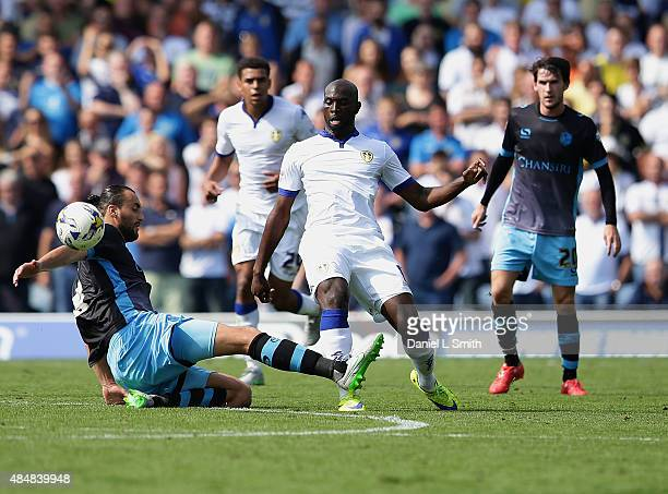 Atdhe Nuhiu of Sheffield Wednesday FC tackles Souleymane Doukara of Leeds United FC during the Sky Bet Championship match between Leeds United and...