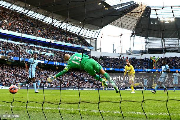 Atdhe Nuhiu of Sheffield Wednesday scores the opening goal past goalkeeper Wilfredo Caballero of Manchester City during the FA Cup Third Round match...