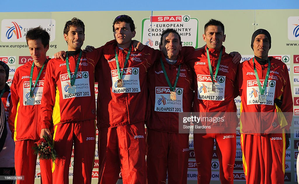 AThe Spanish team celebrates with their gold medals after winning the Senior Men's Team race during the 19th SPAR European Cross Country Championships on December 9, 2012 in Budapest, Hungary.