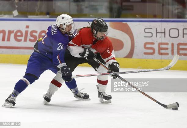 Athena Locatelli of France and Monika Vlcek of Austria vie during the Ice Hockey Women's World Championship Division 1 Group A in Graz Austria on...