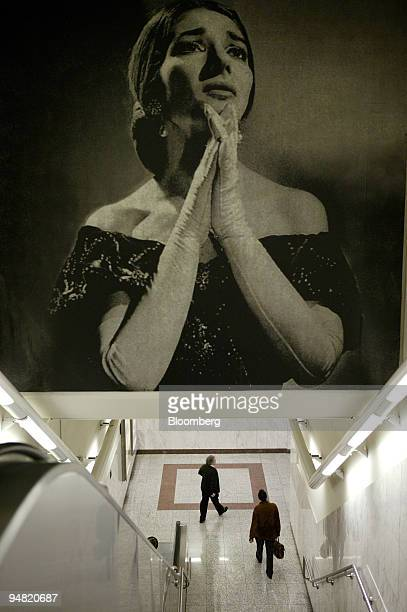 Athenians walk under a picture of opera singer Maria Callas at the Megaron subway station in Athens Greece Monday March 28 2005