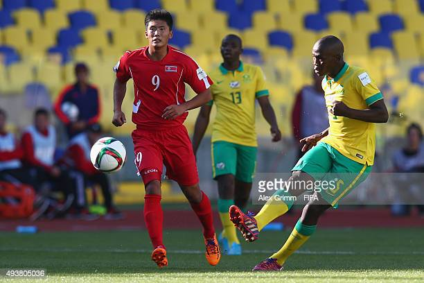 Athenkosi Dlala of South Africa is challenged by Han Kwang Song of Korea DPR during the FIFA U17 World Cup Chile 2015 Group E match between South...