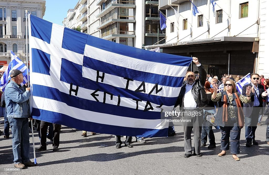 Athens 11 May 2011, Protesters hold the Greek flag outside parliament as thousands of workers gathered for the general strike