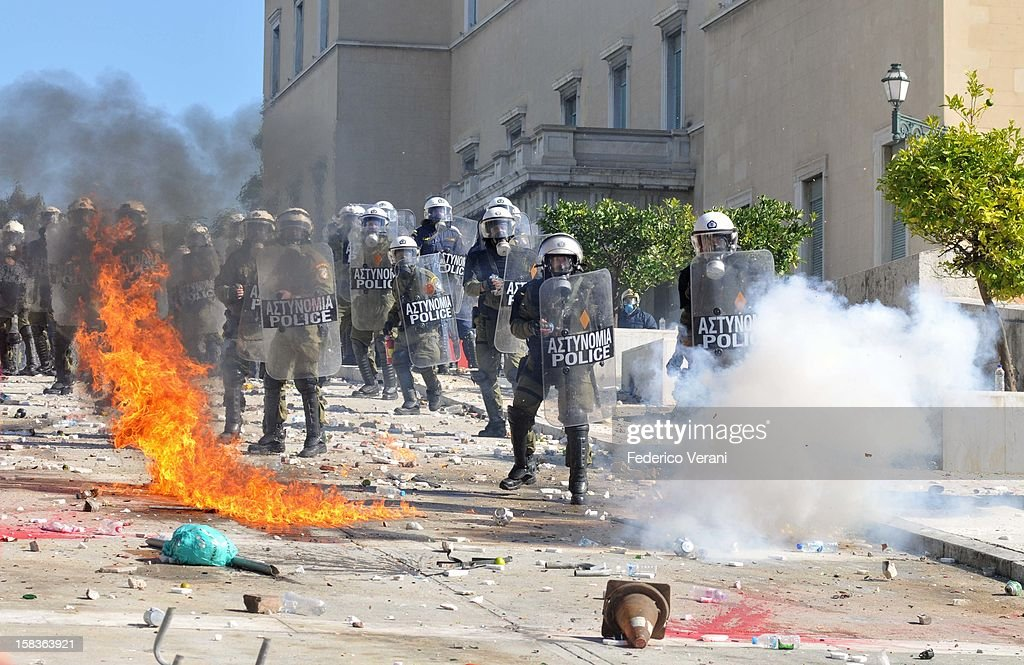 Athens 19 October 2011, Protesters hurl molotov cocktail bombs towards riot police in Sytagma square during the general strike