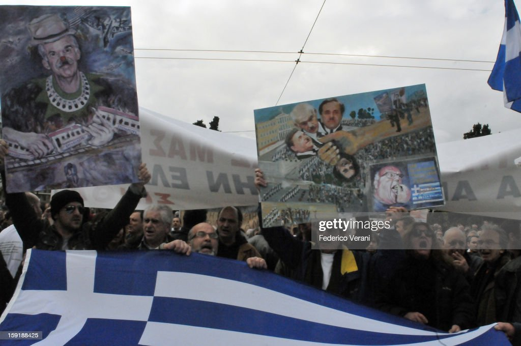 CONTENT] Athens 23 February 2011, Protesters hold the Greek flag outside parliament as thousands of workers gathered for the general strike
