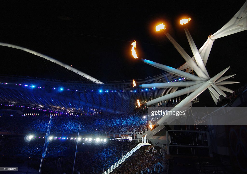 flame lighting olympics. a photo illustration shows the olympic flame as it descends 29 august 2004, during lighting olympics